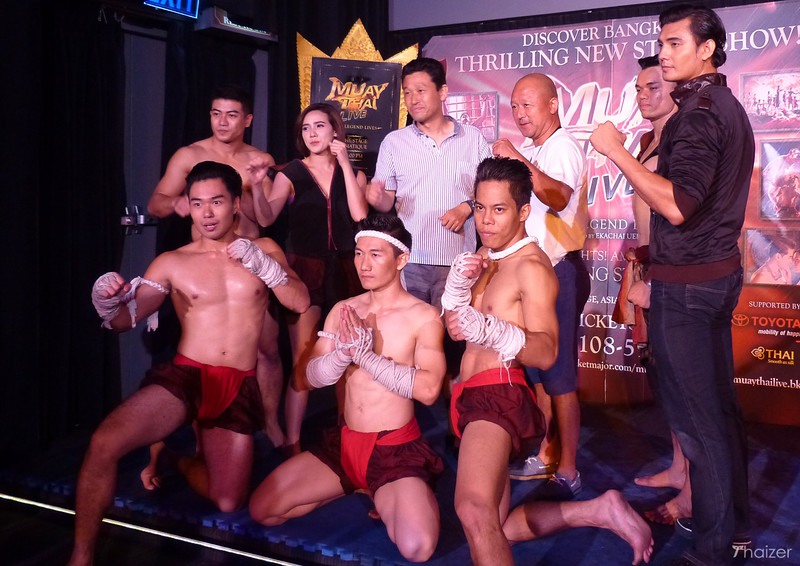 Muay Thai Live cast members posing for photos