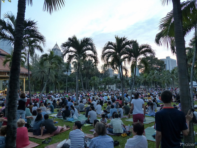 crowds watch free concert in Bangkok's Lumphini Park