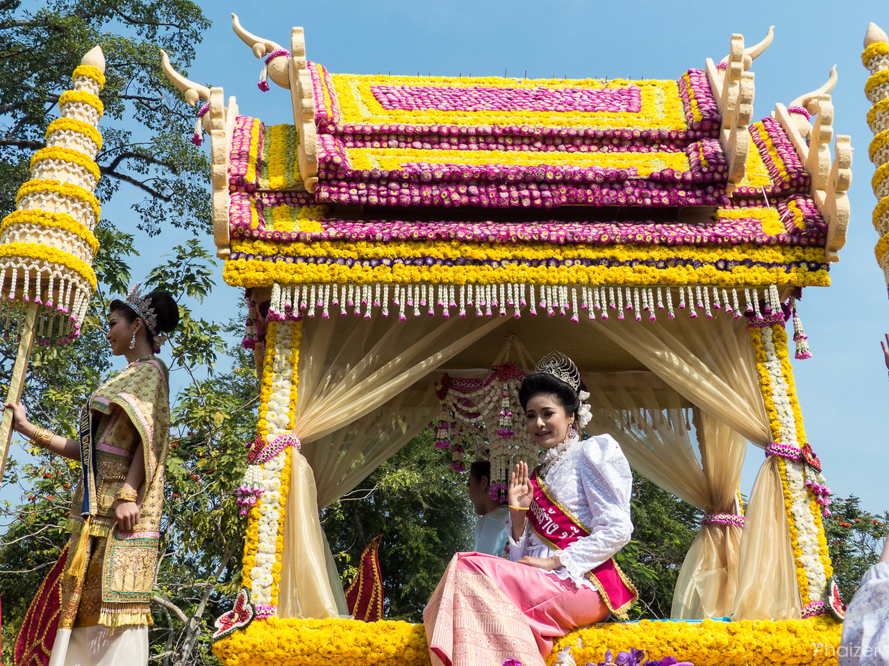 waving from the float at Chiang Mai Flower Festival
