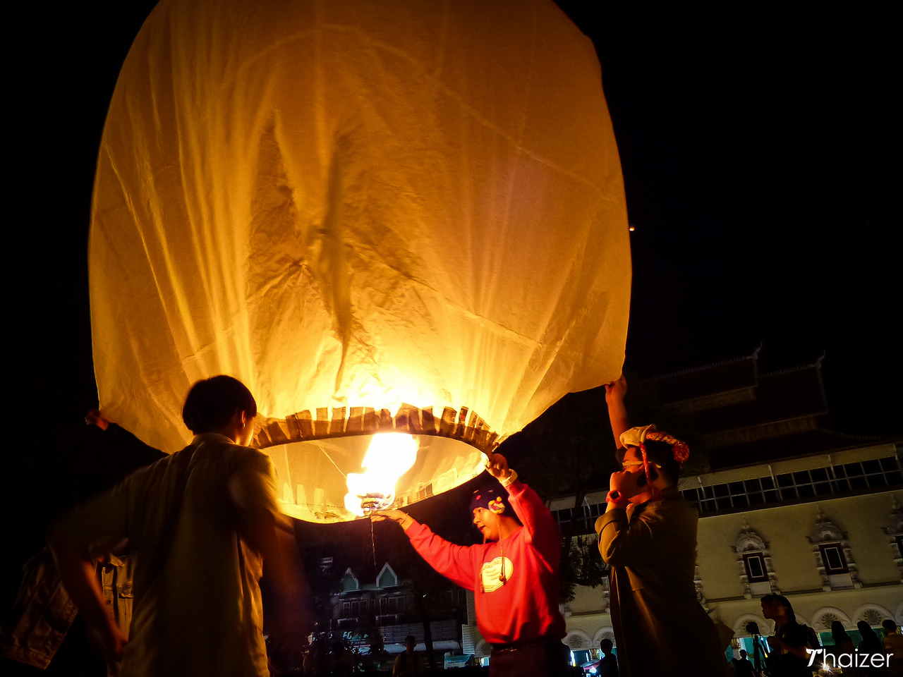 releasing sky lanterns at Three Kings Monument, Chiang Mai